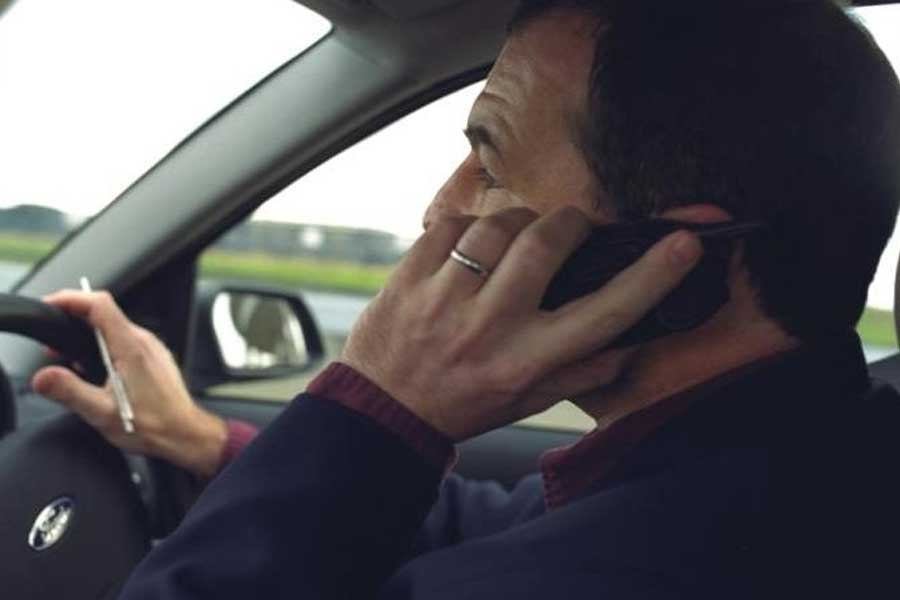 Nearly 50 drivers caught using their mobile every hour.................