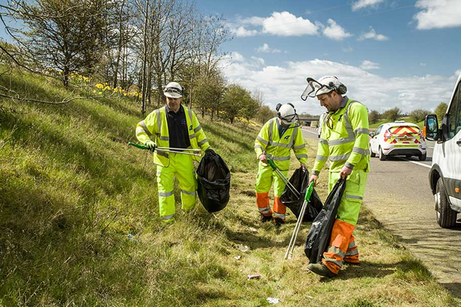Highways England contractors pick litter on the roadside on the A66