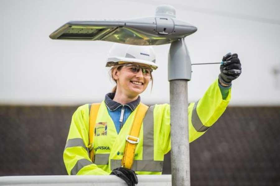 Image of worker installing street light
