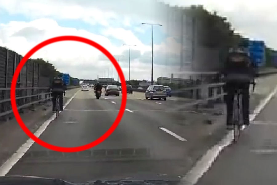 Shocking moment cyclist rides along M25…