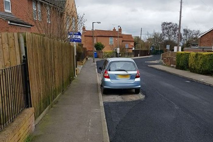 Highways workers forced to resurface road around parked car