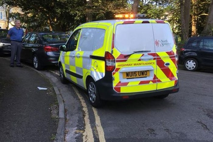 Council staff park on double yellow lines only to issue tickets to people doing the same