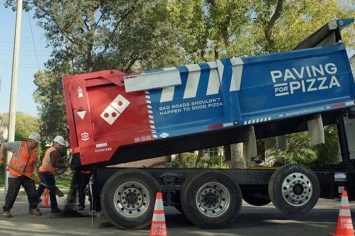 Domino's branded potholes appear after pizza company takes to road repair
