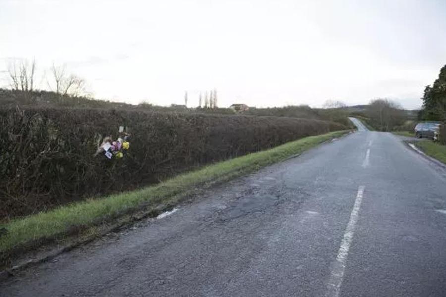 Triathlete died when her bike hit a pothole