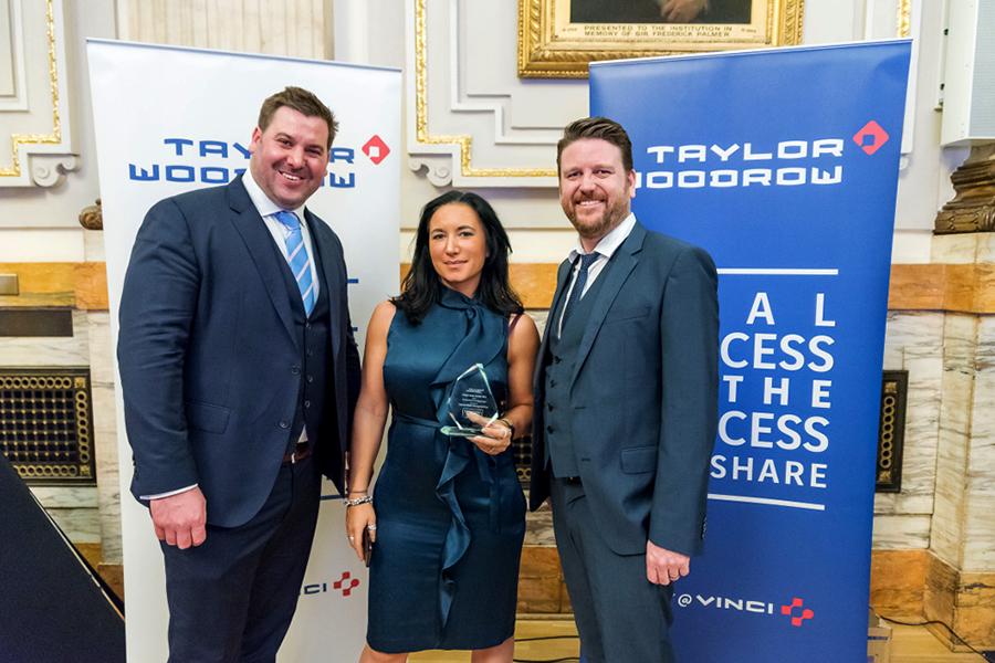 Chevron's Matt West, Lisa Killinger and Nick Denning proudly showcase the award