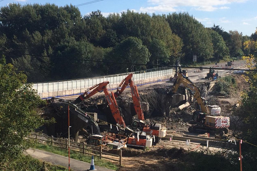 Caption: Work continuing on the demolition of the western part of the Romsey Road bridge over the M27 in Hampshire