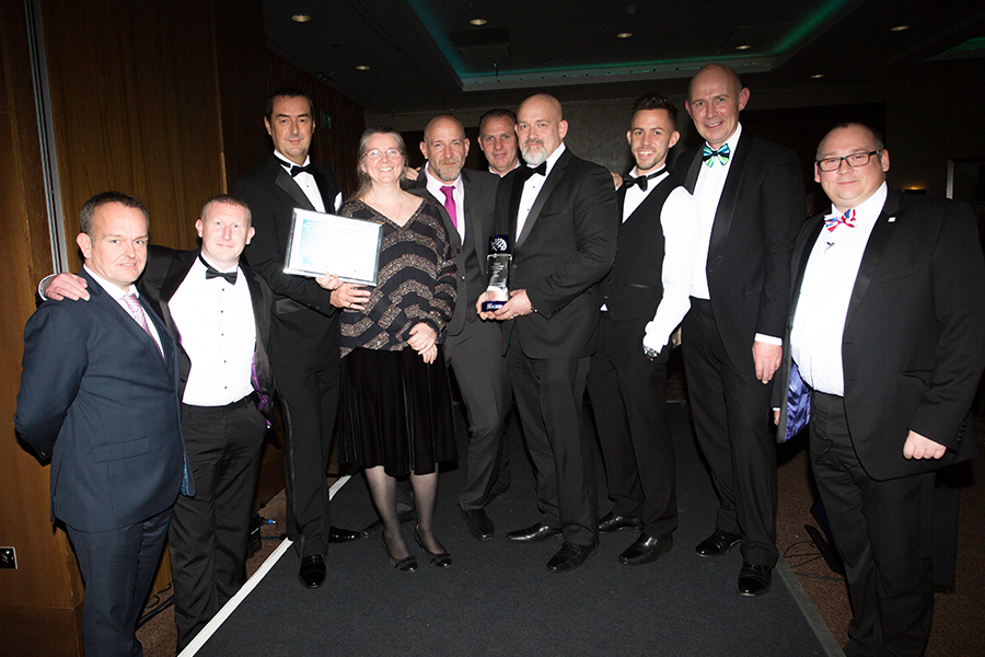 The area 3 team collecting the award