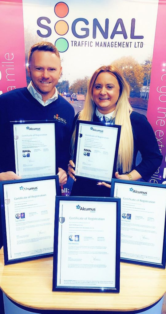Image: Signal Directors Matt & Sarah Eaton proudly display the Alcumus certificates