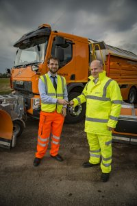 Stephen McKeown hands over the keys to Nick Harris, Highways England's executive director of operations