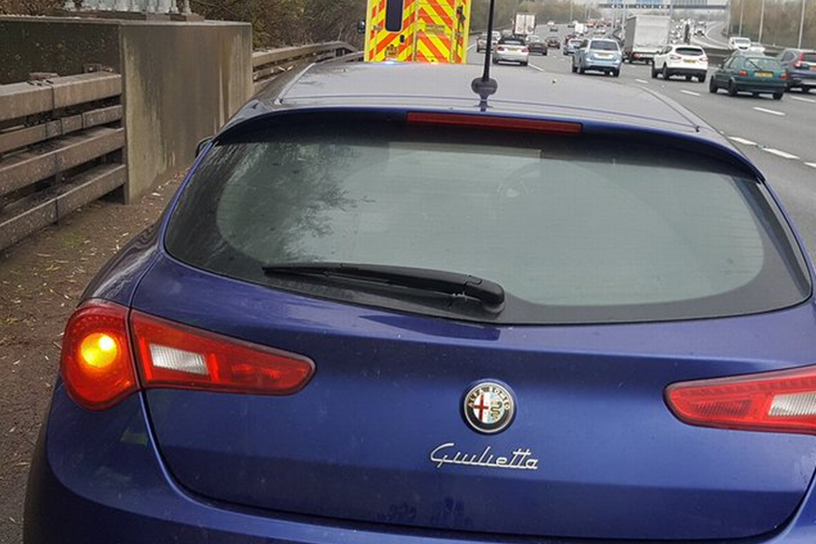 The man was in a blue Alfa Romeo (Image: Surrey Police)