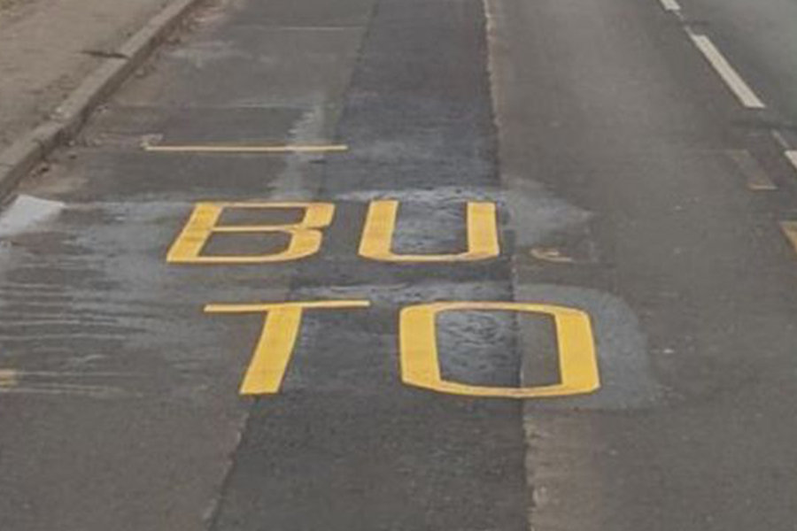 In one street, painters had not completed the words at a bus stop. Photo: Raymond Docwra
