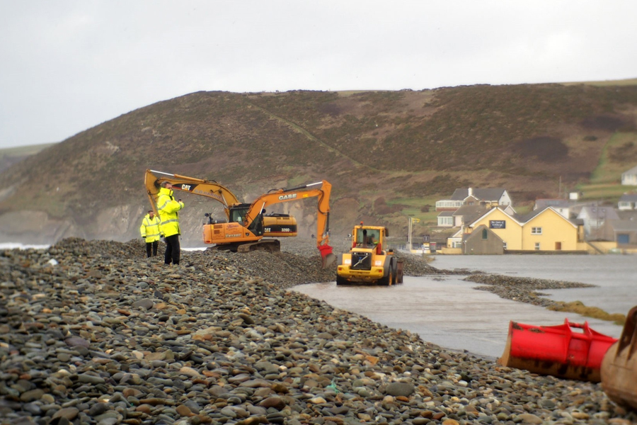 Diggers attempt to clear road at Newgale in January 2014. PICTURE: Western Telegraph.