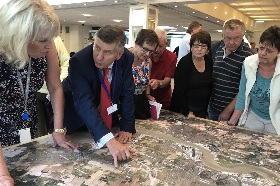 Caption: Lower Thames Crossing technical lead Gary Hodge explains the route to attendees at the first consultation event in Orsett