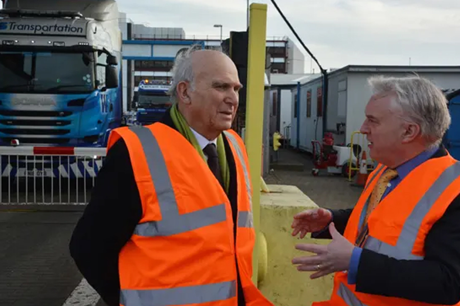 Vince Cable, left, with Gerald Vernon-Jackson, the leader of Portsmouth city council, at Portsmouth international port. Photograph: Ben Mitchell/PA