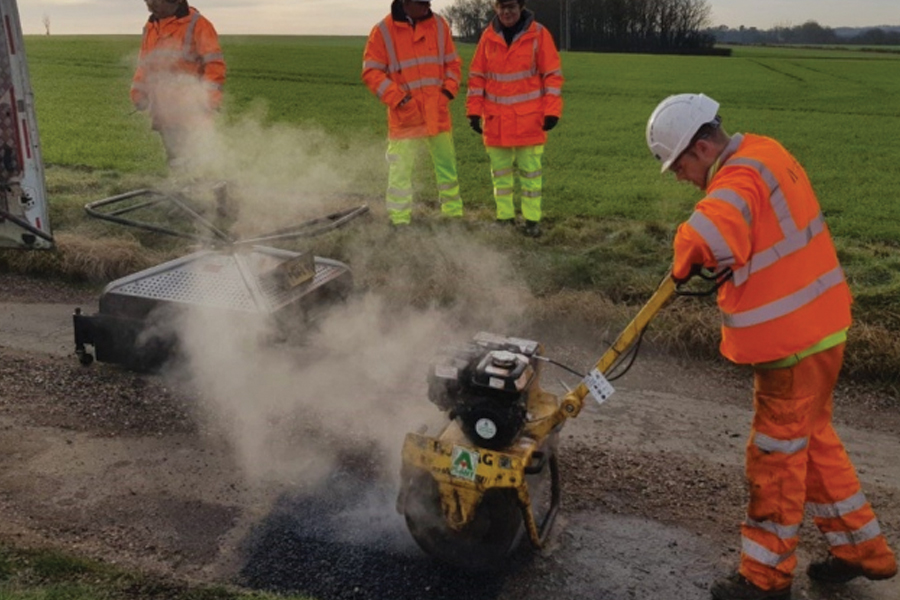 Suffolk County Council highways cabinet member Mary Evans visits teams repairing potholes with new thermnal patching technology in Stoke-by-Clare. Picture: SUFFOLK HIGHWAYS