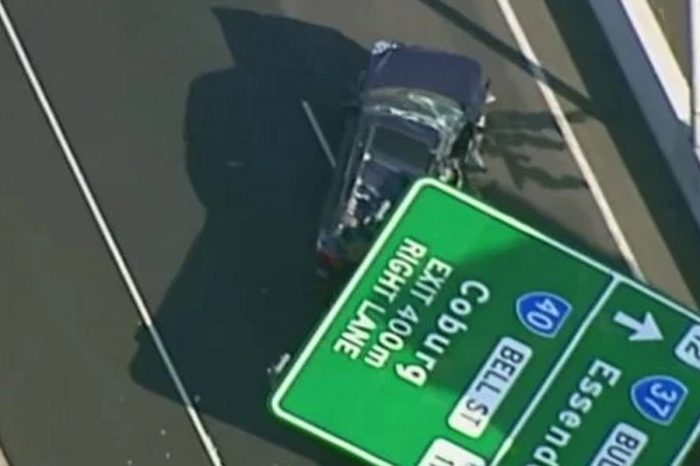 The huge sign fell on top of her car while she was driving along the Tullamarine Freeway in Melbourne, Australia