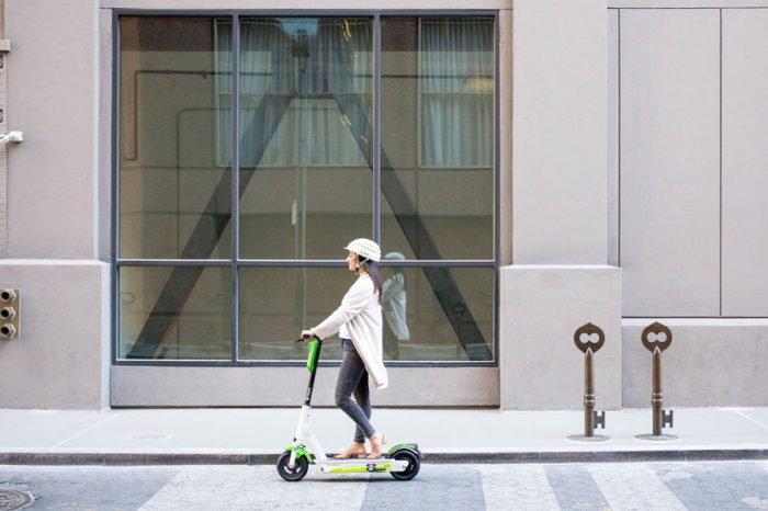 Several firms across the world offer electric scooters for hire (Lime/PA)