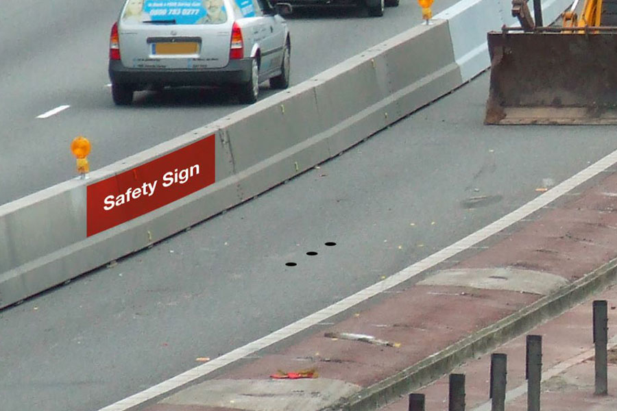Image shows clearly where the colour coded reminder deflection sits as well as road studs set parallel to barrier as physical reminder at correct deflection distance