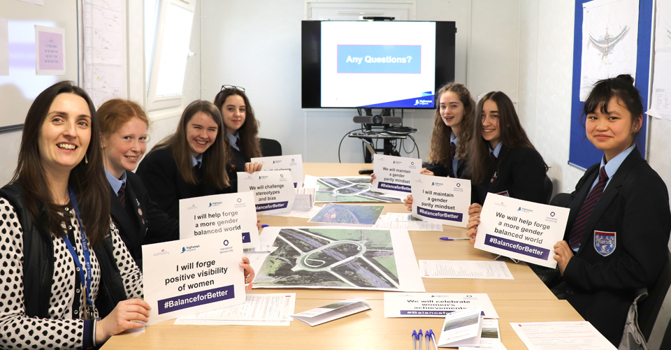 From left, Bristol Free School teacher Jenny Street and pupils Emma, Flo, Anna, Amy, Sophia and Sam pictured in the site office at the M49 junction scheme at Avonmouth on International Women's Day