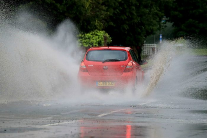 Sinkholes force closure of M25 as deluge prompts flood warnings across Britain