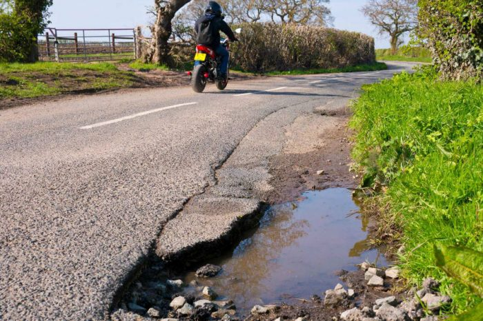 Money cut from road budgets would fill 8 million potholes, councils claim