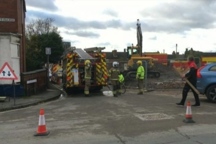 Construction worker dies after being trapped under a digger